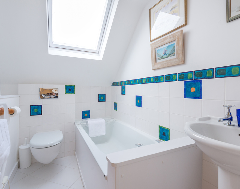 The fresh, second floor bathroom of Hob House, a holiday house at Daymer Bay, Cornwall, with velux window.