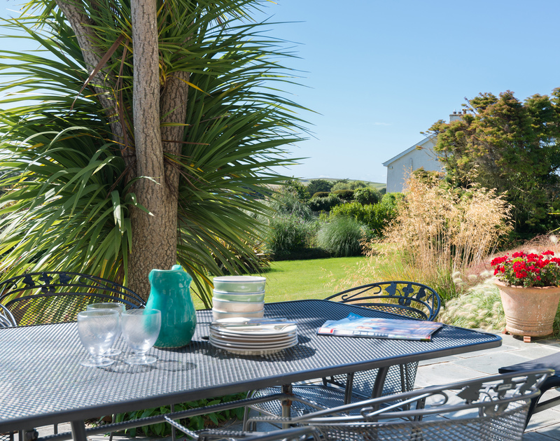 Gorgeous views from the terrace at Hob House, a holiday house at Daymer Bay, Cornwall, with its mediterranean style planting.