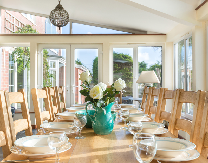 The elegant and airy dining room of Hob House, a self-catering holiday house at Daymer Bay, Cornwall