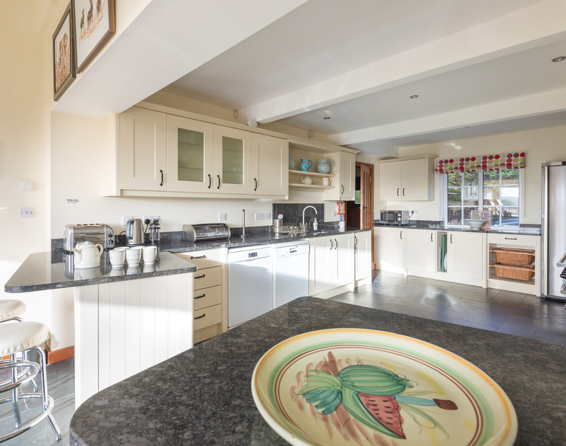 The large coastal shaded kitchen diner, well equipped with views of the garden at Hob House,
