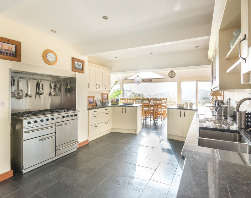 The large, open-plan kitchen of Hob House, a self-catering holiday house at Daymer Bay, Cornwall, with its range cooker.