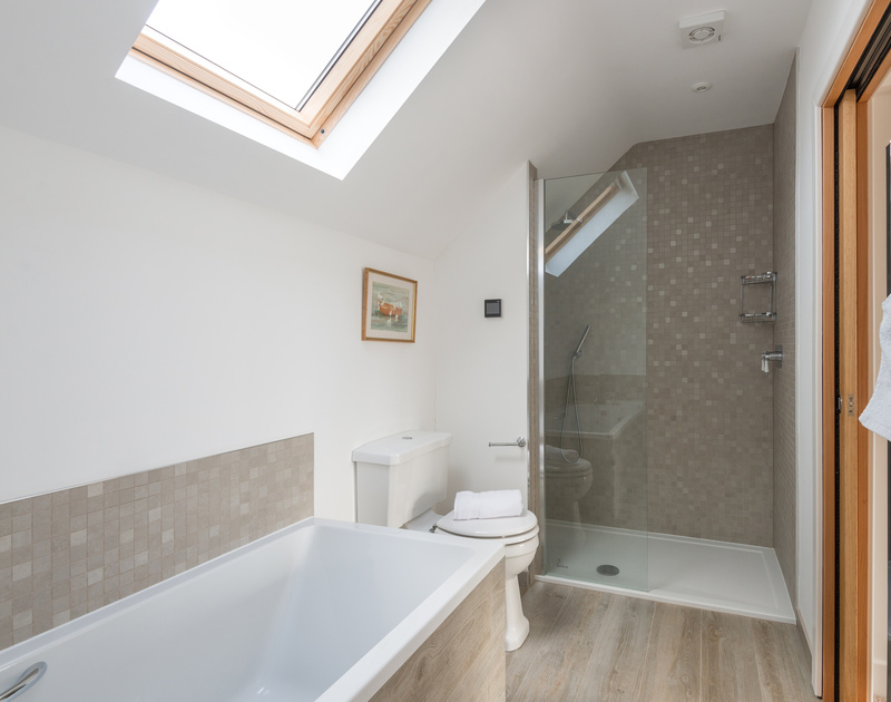 A luxury ensuite bathroom off the king bedroom with separate bath and shower at Hob House.