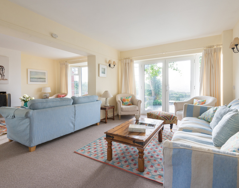 Lots of choice for a comfortable seat on one of the many sofas or armchairs in the sitting room at Hob House in Daymer Bay.
