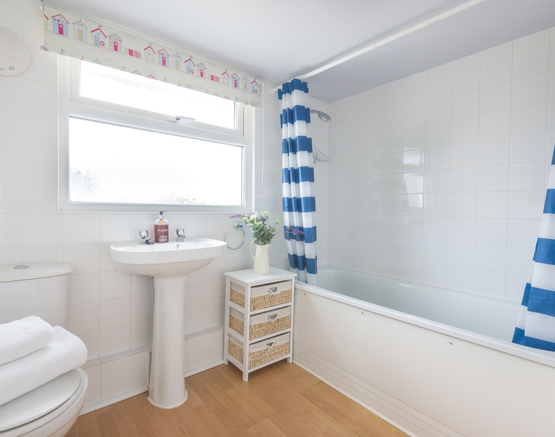 The family bathroom on the first floor at Tregenna, self catering, holiday accommodation in Port Isaac in North Cornwall.