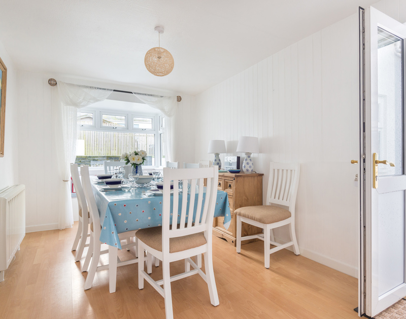 The bright dining room at self catering holiday rental Tregenna tucked away in Port Isaac in North Cornwall.