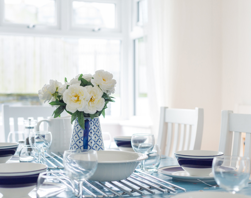 Blue and white crockery on the dining table at holiday rental Tregenna in Port Isaac in North Cornwall.