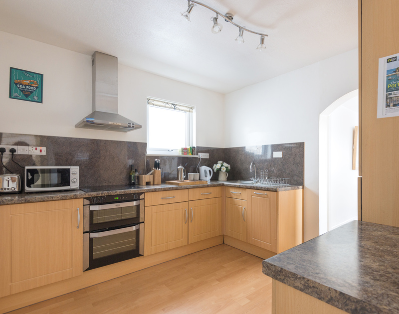 Lots of room in the modern kitchen for preparing family meals at holiday cottage Tregenna in Port Isaac in North Cornwall.