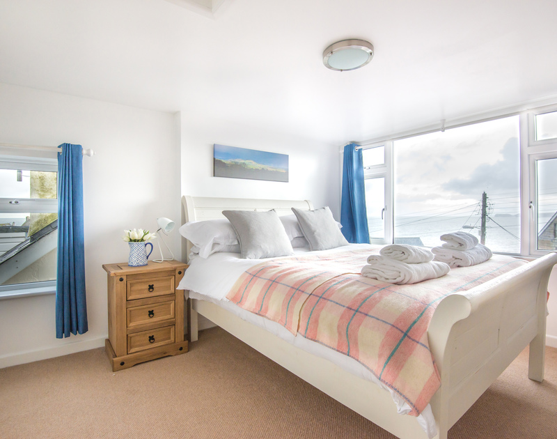 The master bedroom on  the first floor with sea, coastal and countryside views at Tregenna in Port Isaac, North Cornwall.