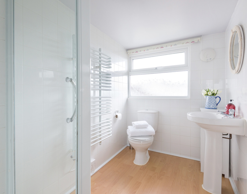 The spacious ensuite shower room for the master bedroom at Tregenna, a self catering holiday cottage in Port Isaac in North Cornwall.