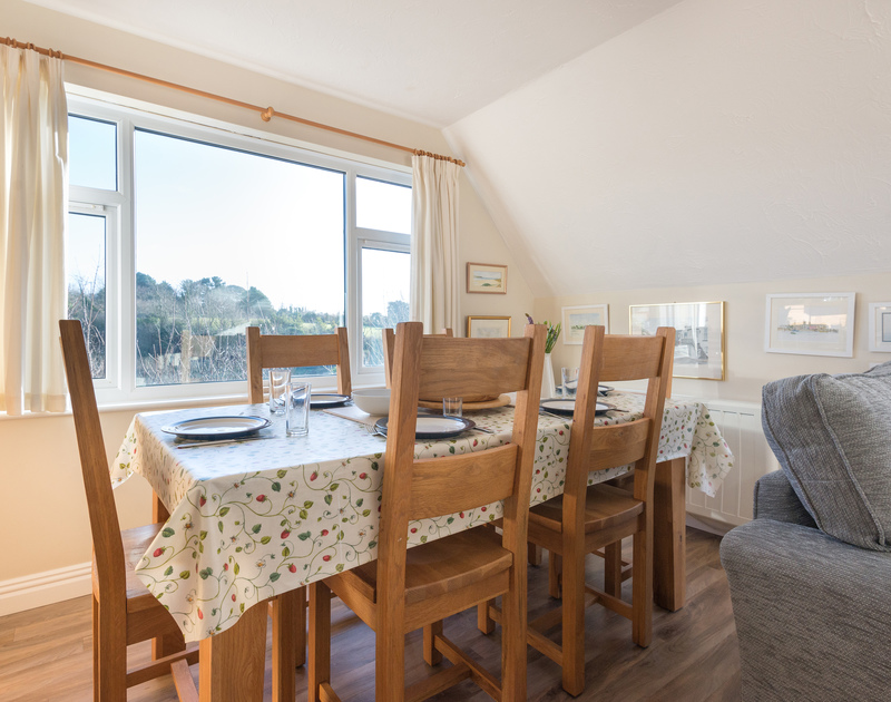 The light and airy dining area at Talland House, a self catering holiday house to rent in a tucked away position in Rock, Cornwall.