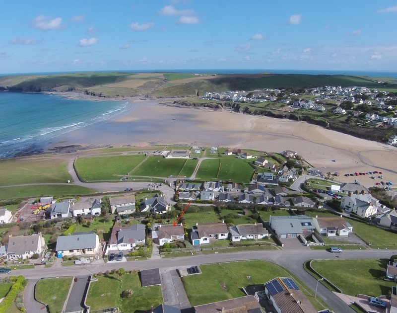 An aerial view of the location of self catering, holiday house to rent Trelorna, in a cliff top location above the beach in Polzeath, Cornwall.