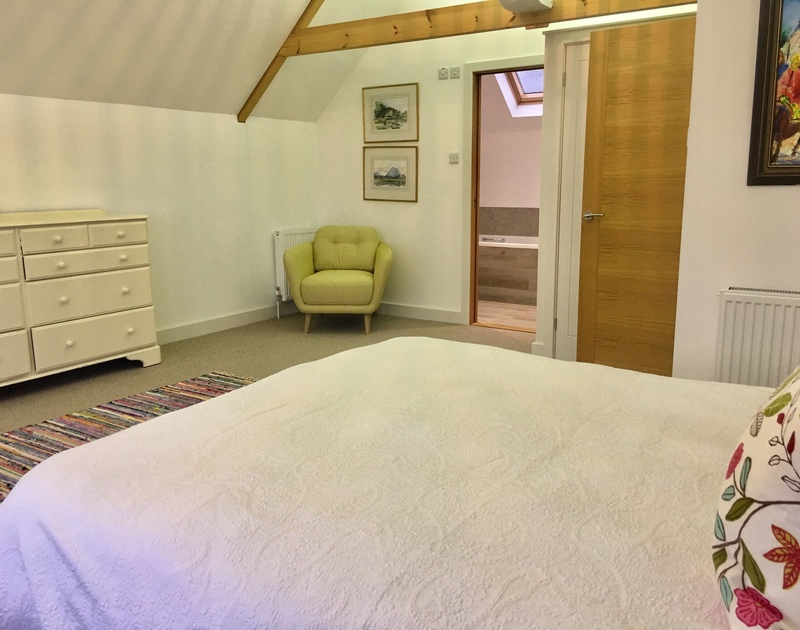 The spacious king bedroom that extends out onto the balcony with plenty of storage and ensuite bathroom with separate shower.