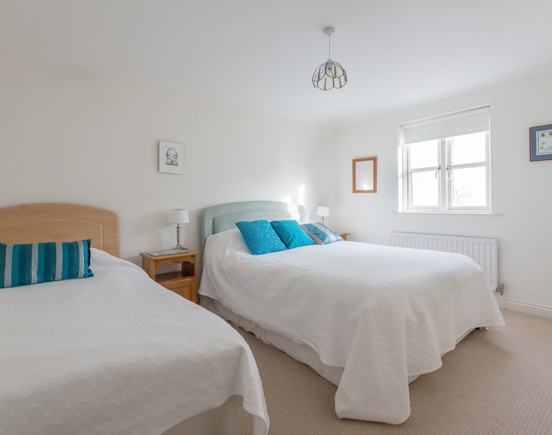 Useful triple bedroom on the ground floor with an ensuite shower room at self catering, family holiday house Cliffside 1 in Port Isaac in North Cornwall.