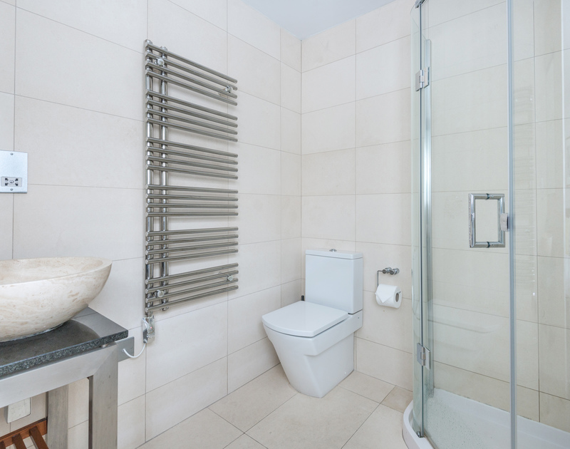 This fully tiled, contemporary shower room is the ensuite for one of the double bedrooms at Number 9,  a self catering holiday house in Port Isaac.