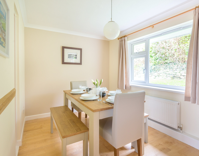 The dining table beside the window at Sunnybank, self catering holiday accommodation just five minutes walk away from Port Isaac's pretty harbourside on the North Cornish Coast.