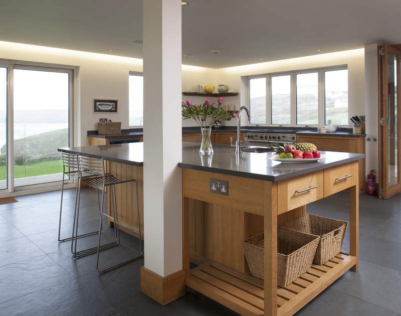 The open plan kitchen leads off from the sitting room and is the perfect place to admire the panoramic views at Greenaway Reach, in North Cornwall