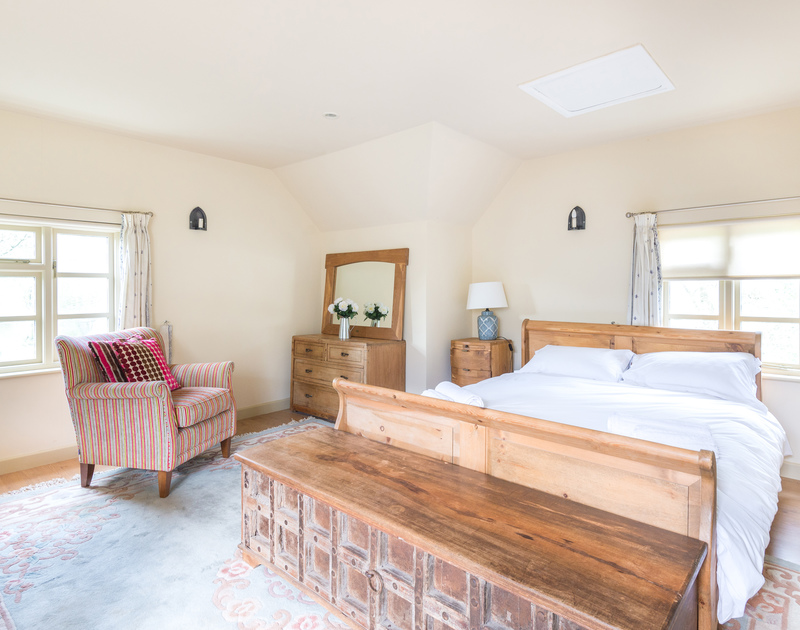 The traditional annexe at Porthilly Greys, open plan double bedroom with plenty of storage, kitchenette and shower room ensuite