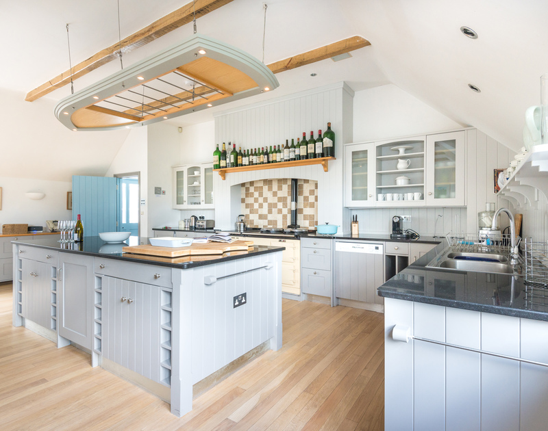 The large well equipped kitchen space at Old Brea Coach House complete with an aga and two dishwashers to cater for those dinner parties.