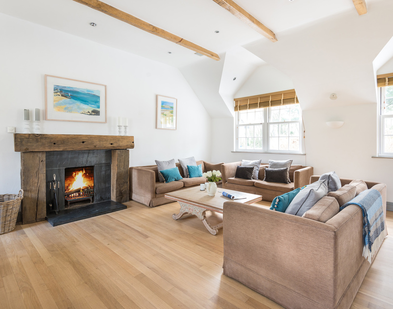 The large contemporary open plan kitchen, dining and living area at Old Brea Coach House, Rock