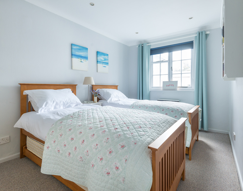 A restful, simple twin bedroom at Little Strand, a holiday rental in Rock, Cornwall