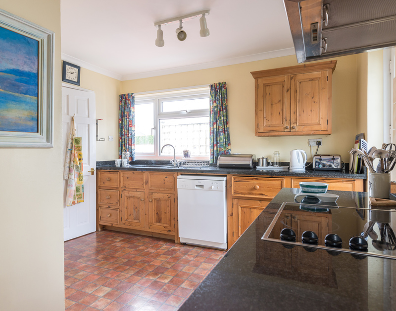 The kitchen with external door in Little Sailing, a self catering holiday bungalow in Rock, North Cornwall.