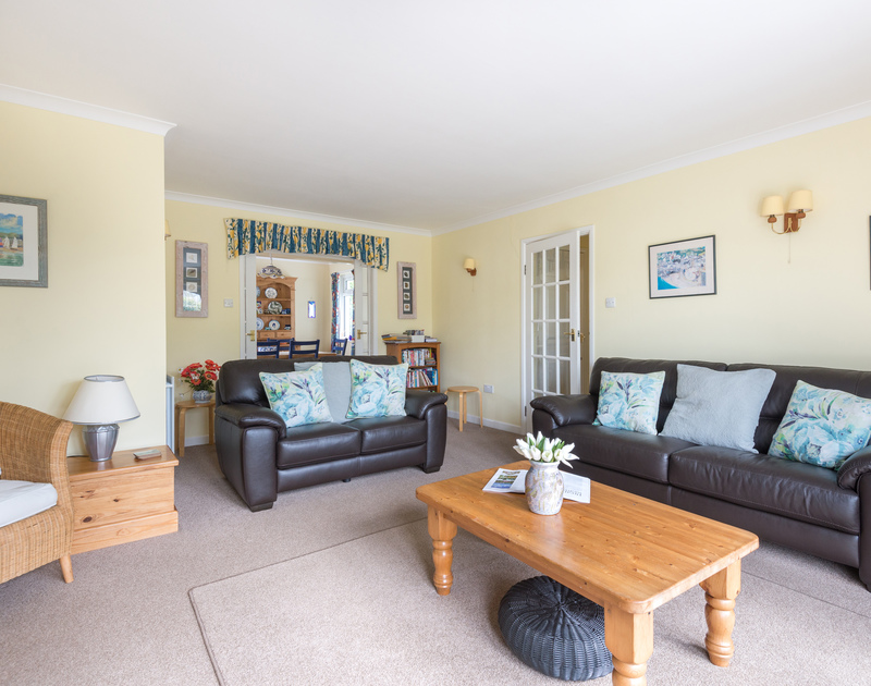 The comfortable sitting room at Little Sailing with access into the dining kitchen area and the garden.