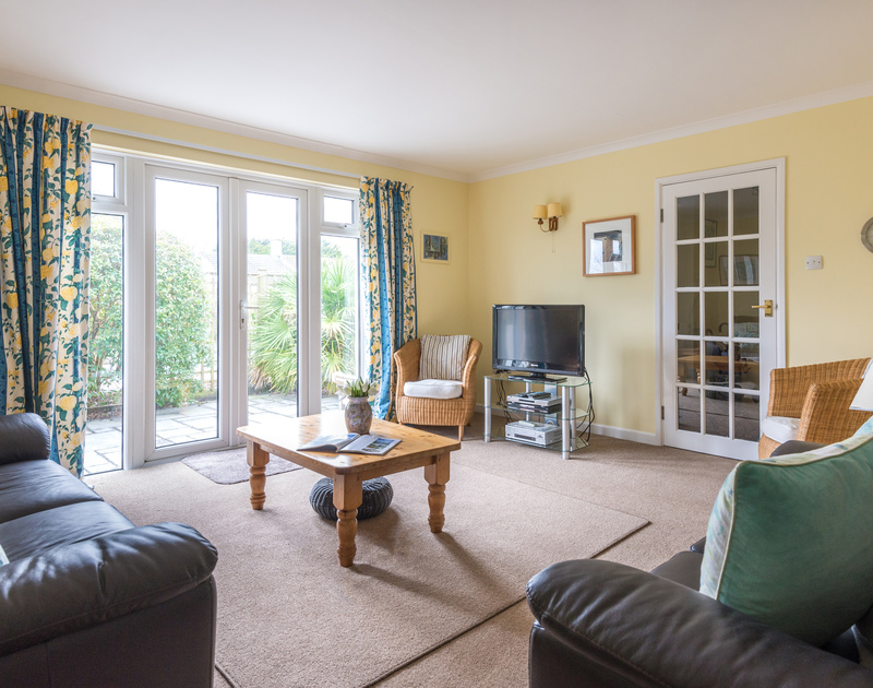 The spacious sitting room in Little sailing, a self catering holiday house to rent in Rock, North Cornwall.