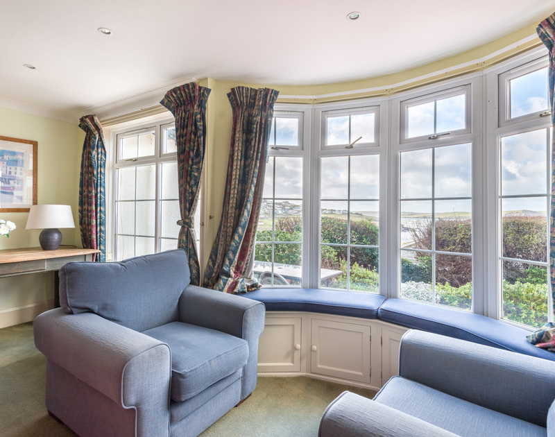 Relax in a couple of armchairs in the living room and enjoy the stunning Polzeath views.