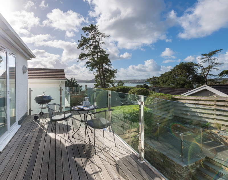 Soak up the sea air on the decking at Lyonesse, a holiday home in Rock.
