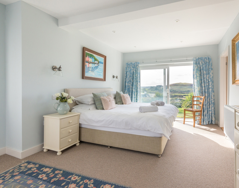The chic super king bedroom is spacious with coastal views through the juliet balcony. This bedroom has the added luxury of a large bathroom ensuite with a separate shower.