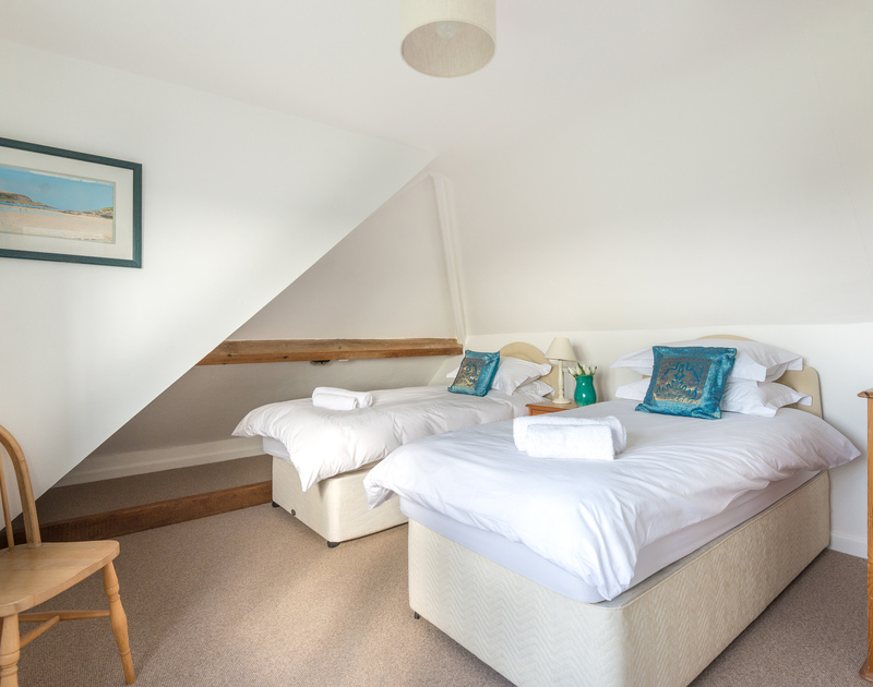 The second floor contemporary twin bedroom on the right hand side with a bathroom ensuite