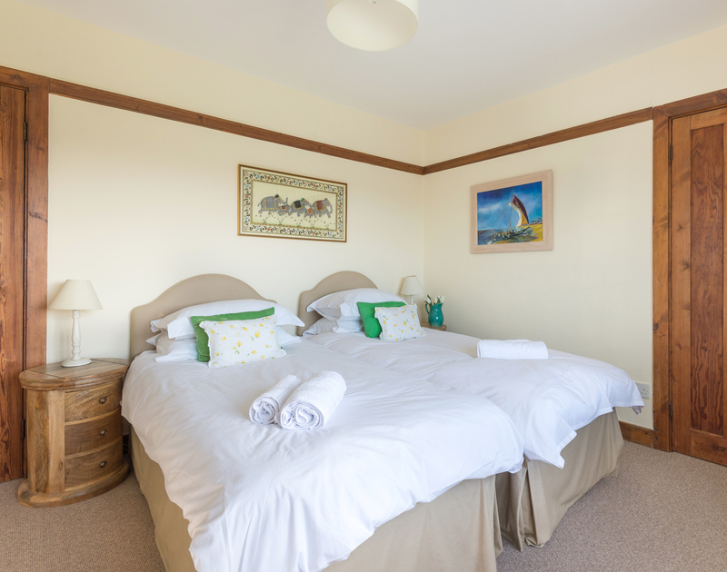 Spacious, double bedroom with kingsize bed at Hob House, a self-catering holiday house at Daymer Bay, Cornwall