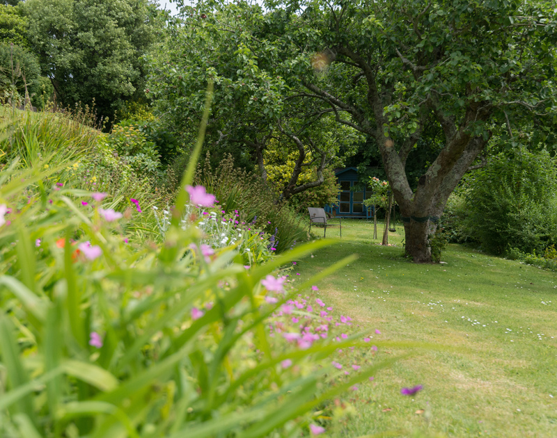 So much garden to explore or simply find a spot in the shade under one of the many trees and enjoy the peace at tucked away, family holiday house Sliggon Field.