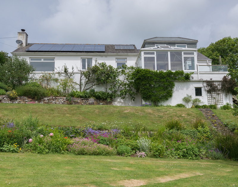 The exterior of Sliggon Field, set within beautiful gardens, a haven for nature lovers yet also walkable distance of the beaches of Polzeath, Greenaway and Daymer Bay.