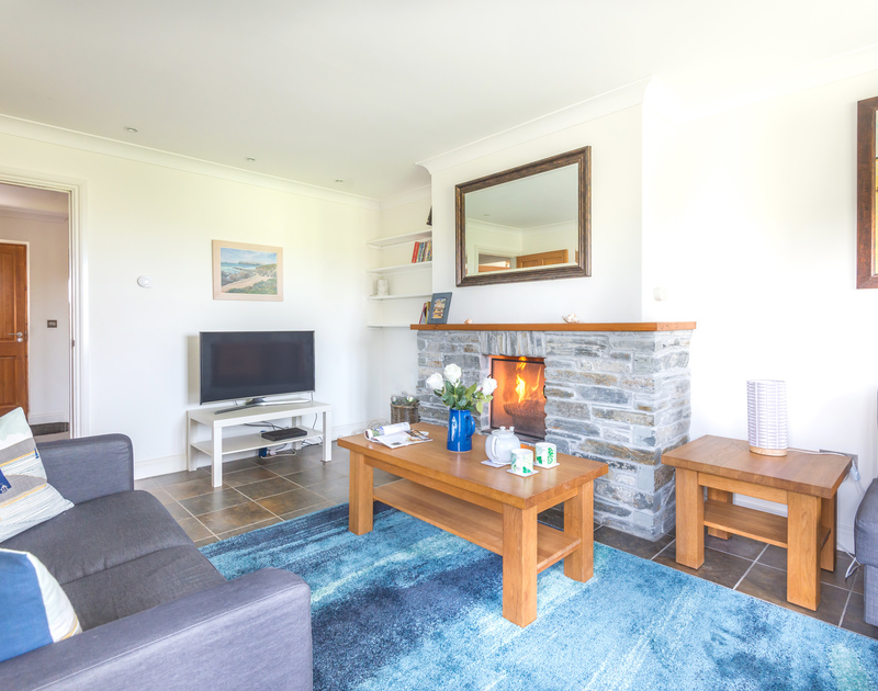 Cosy sitting room at Lundy Cottage with an open fire for cooler days in Rock, North Cornwall.