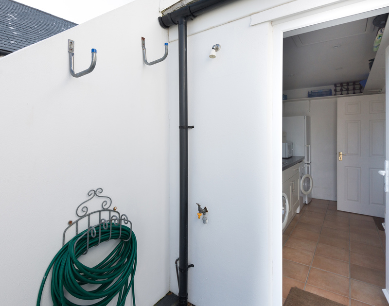 The outside shower, perfect to wash off your beach gear ready for another action packed day from Pengelly.