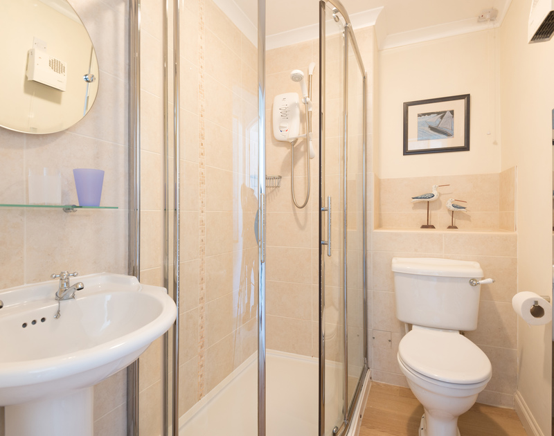 the modern twin bedroom shower room ensuite at Pengelly.