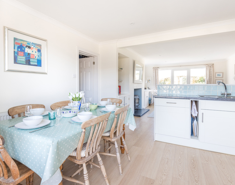 The light kitchen and dining table at Pengelly in Polzeath, north Cornwall.