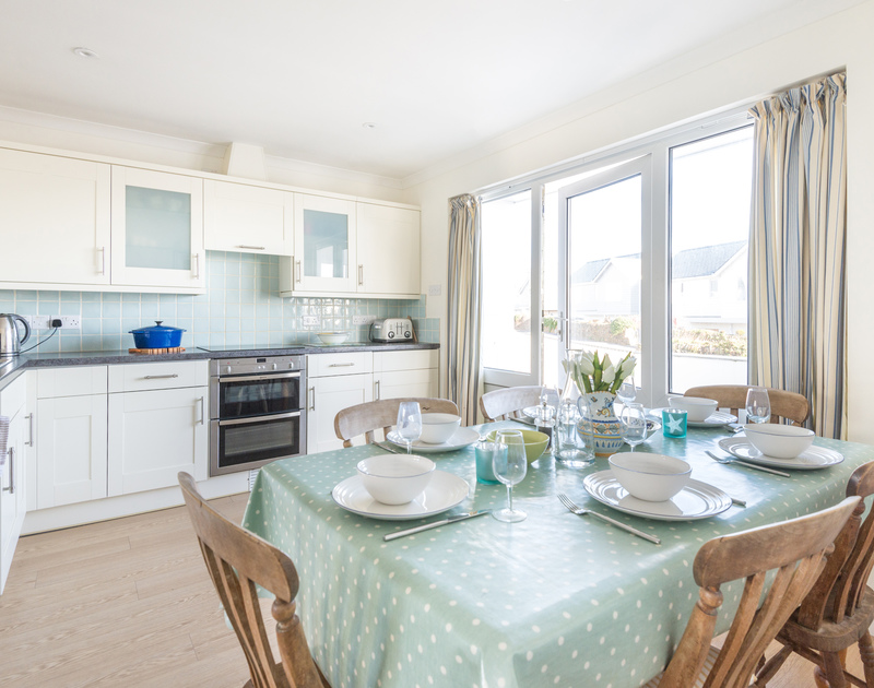 The kitchen with large glass doors at Pengelly self catering holiday home in Polzeath, North Cornwall.