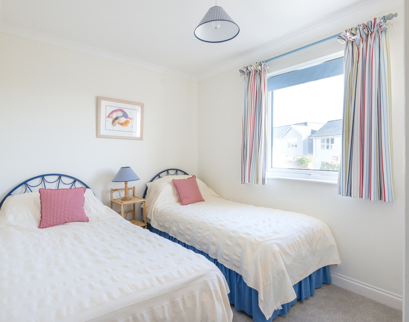 the twin ensuite bedroom in Pengelly, a modern self catering holiday home in Daymer Bay