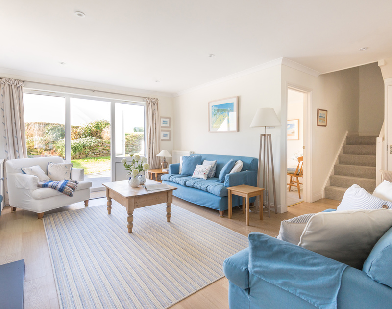 The comfortable living room with patio doors to the garden at Pengelly self catering holiday home in Port Isaac, North Cornwall.