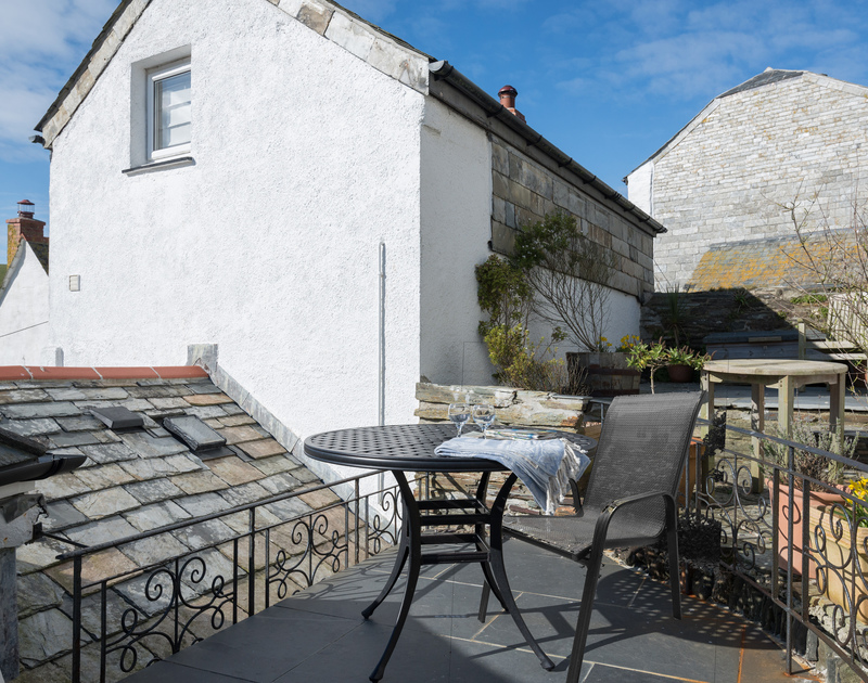 Take a drink outside and enjoy the fresh Cornish sea air on the sunny patio area behind Bre Cottage, self catering holiday accommodation in picturesque working fishing village Port Isaac in North Cornwall.