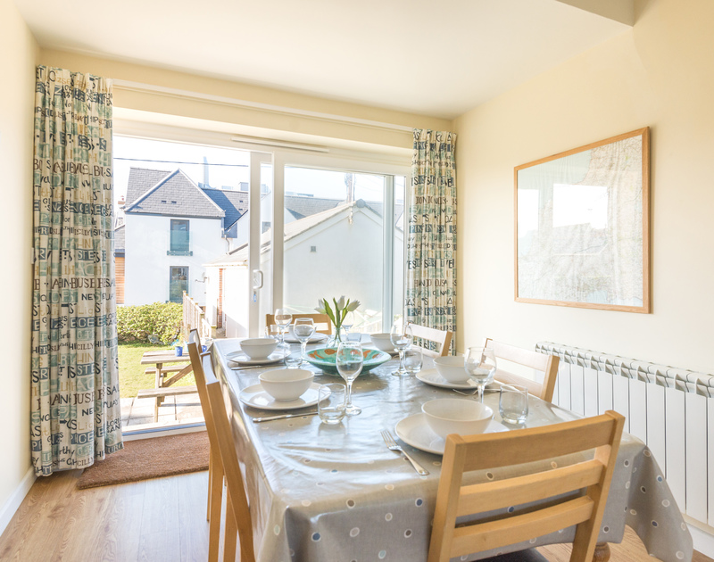 The bright dining area, part of the open plan living room at The Holiday House in new polzeath