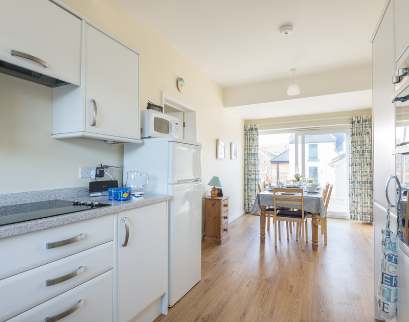 The open plan kitchen/diner in The Holiday House, a self catering, pet friendly, holiday rental in New Polzeath, North Cornwall.