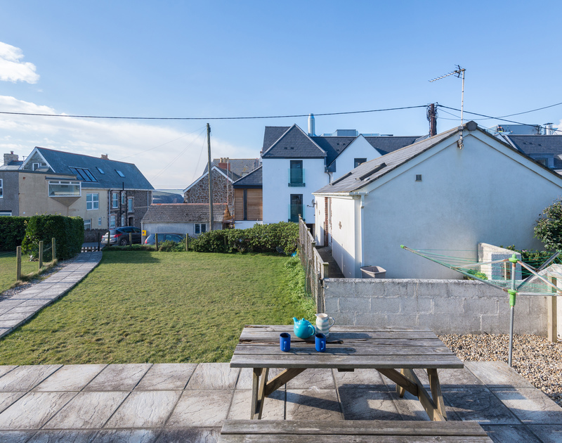 The private garden and sun terrace at The Holiday House in New Polzeath