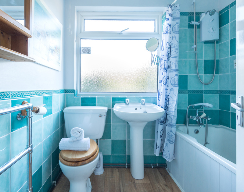 The family bathroom of Bella Vista, a holiday apartment near the beach in Polzeath, North Cornwall.