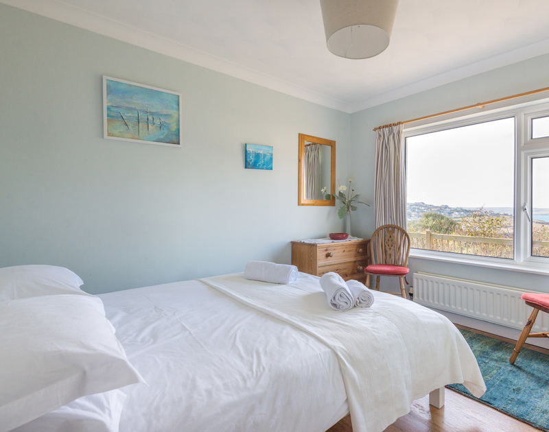 The double bedroom at Bella Vista, a self-catering holiday flat in Polzeath, North Cornwall.