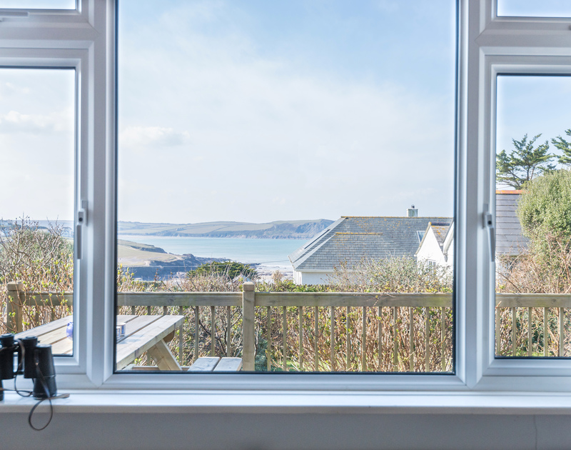 Views over the sea to Stepper point on the opposite side of the Camel Estuary from Bella Vista self catering holiday home in Polzeath, North Cornwall.