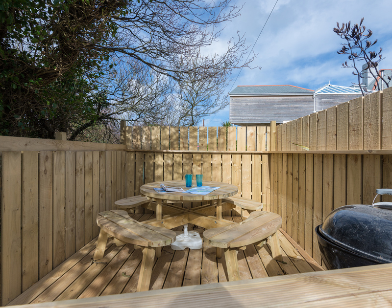 Wooden, sheltered barbeque area at Beachside, a self catering, holiday house right by the sea and sands of Polzeath in North Cornwall.