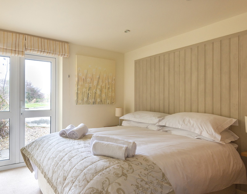 Calming neutral tones in the ground floor double bedroom at self catering holiday home Beachside in Polzeath.